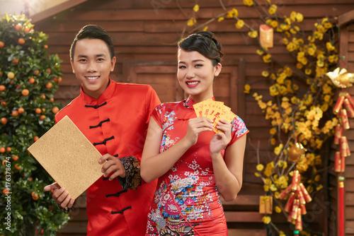 joyful young couple wearing traditional