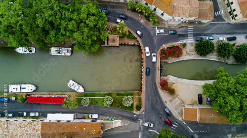 Poster Channel Aerial top view of boats and lock in Canal du Midi, road and bridge from above, Southern France