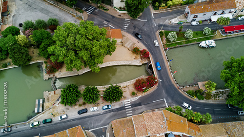 Foto op Plexiglas Kanaal Aerial top view of boats and lock in Canal du Midi, road and bridge from above, Southern France