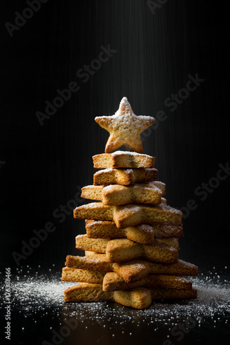 Gingerbread Star Shaped Cookies Stacked In Christmas Tree Concept