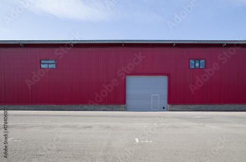 Staande foto Industrial geb. red metal warehouse with gates,garage