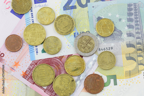 Euro banknotes and coins close uup in studio  - Buy this stock photo
