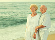 man and woman standing on the sea shore