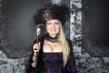 Pretty Blonde Woman Wearing Historical Purple Black Long Dress