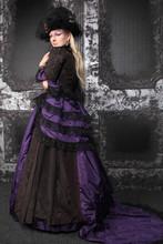 Pretty Blonde Woman Wearing Historical Purple Black Long Dress