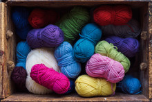Close Up Of Colourful Balls Of Wool In A Wood Box