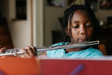 Young African American Girl Practicing Flute