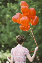 Young Woman With Red Balloons ...