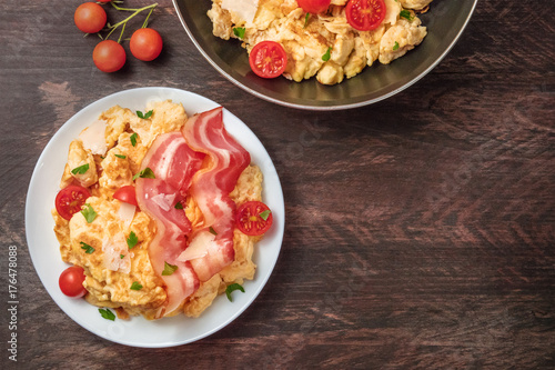 Scrambled eggs with cheese, bacon, and copy space