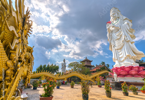 Dong Nai, Vietnam - October 8th, 2017: Bodhisattva architecture in temple afternoon with sun through cloud create auspicious buddha Wallpaper Mural