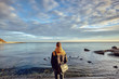 Rear view of man looking out at Bay of Kotor horizon, Montenegro
