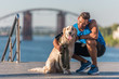 canvas print picture - sportswoman with dog on quay