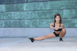 fitness girl with a sports figure doing stretching