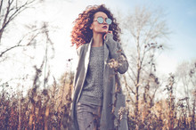 Fashion Beautiful Lady In Autumn Landscape