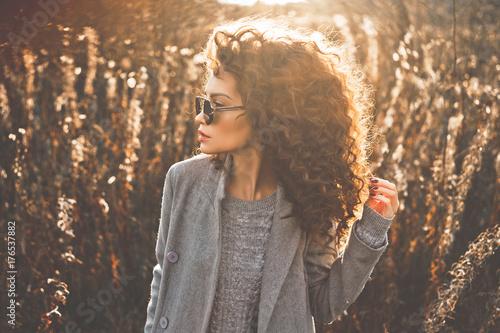 Fashion beautiful lady in autumn landscape