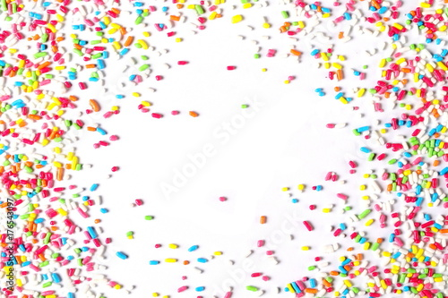Colorful candy sprinkles isolated on white background Wallpaper Mural