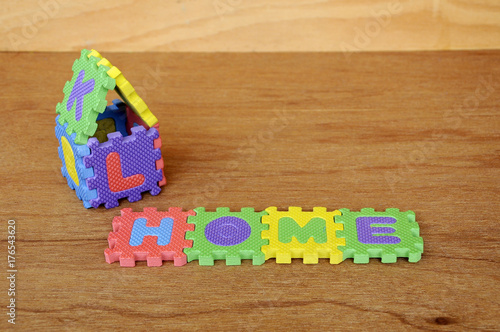 HOME word made from colorful soft rubber mat  Isolated on