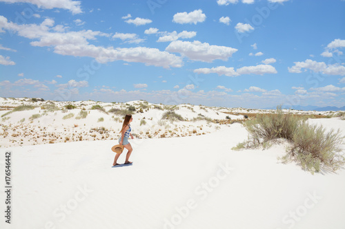 Girl on hiking trip waking to the sand dunes, beautiful desert