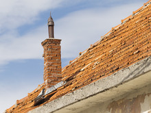 Roof Of Red Shingles With A Pipe