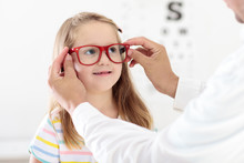 Child At Eye Sight Test. Kid A...