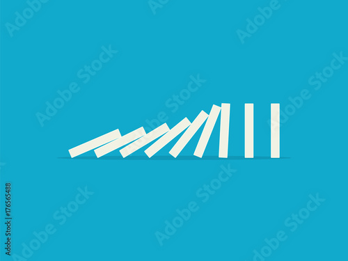 Photo  Falling dominoes on a blue background. Flat design style