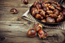 Chestnuts In A Pan On A Wooden Background