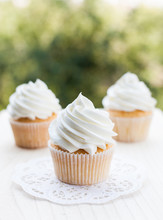 White Vanilla Cupcakes On A Wo...
