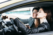 Two girls are riding in a car