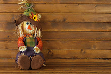 Autumn Scarecrow On Wooden Background