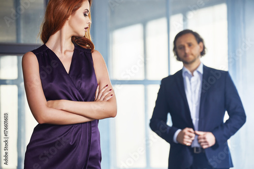 Fototapeta Portrait of young couple in love posing at studio dressed in classic clothes obraz