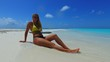 P02716 Maldives white sandy beach 1 person young beautiful woman relaxing on sunny tropical paradise island with aqua blue sky sea water ocean 4k