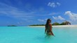 P02737 Maldives white sandy beach 1 person young beautiful woman relaxing on sunny tropical paradise island with aqua blue sky sea water ocean 4k