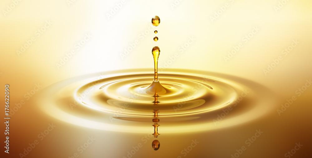 Fototapety, obrazy: Tropfen aus goldenem Öl 2