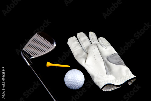 Fotomural Golf Club with Glove Ball and Tee on Black Background