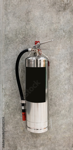 Chrome fire extinguisher hanging on pole - Buy this stock
