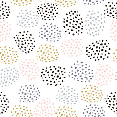 Seamless vector pattern with ink drawn dots. Creative minimalistic crafted background. Great for fabric, wrapping paper, textile