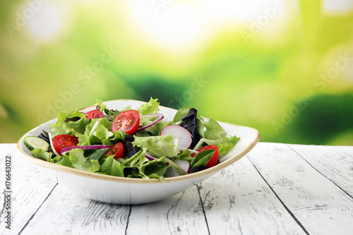 Stampa su Tela bowl of salad with vegetables and greens, with tomato, cucumber and onions