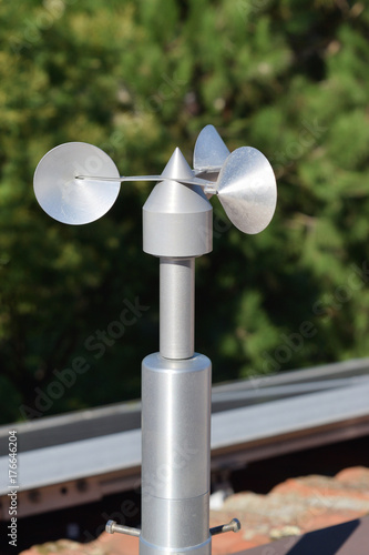 Photo close up of aluminum anemometer on roof