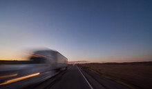 Large Freight Truck On Highway At Dusk