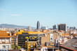 Skyline view with Agbar tower, residential buildings and mountains on the background in Barcelona city