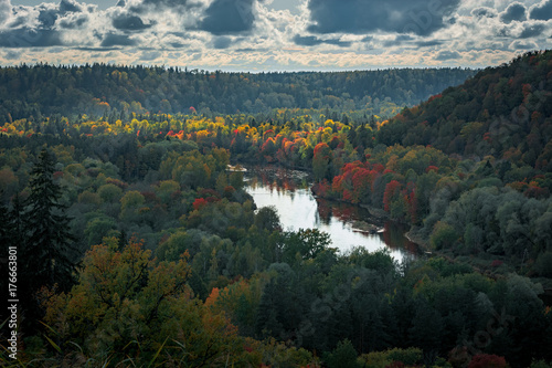 Tuinposter Groen blauw Picturesque view on valley of Gaujas national park. Trees changing colors in foothills. Colorful Autumn day at city Sigulda in Latvia.