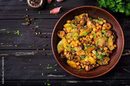 Vegan stir fry of mushrooms, zucchini and chickpea