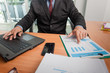 Businessman at working with financial reports