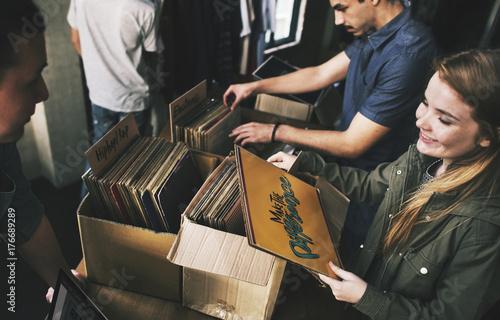Spoed Foto op Canvas Muziekwinkel Young people in a record shop