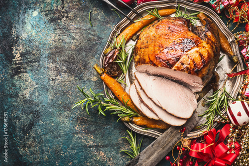 Christmas ham served with roasted vegetables and festive decorations on vintage background, top view, place for text Fototapeta
