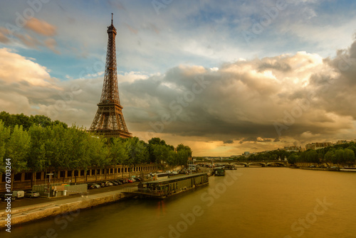 Printed kitchen splashbacks The Eiffel Tower in Paris, France at sunset. Scenic stylized skyline with the river Seine and dramatic clouds. Colourful travel background.