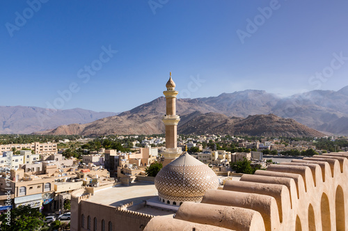 The Grand mosque and minaret in Nizwa viewed from the Nizwa fortress in Oman Canvas Print