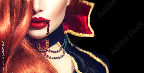 Halloween. Sexy vampire woman with dripping blood on her lips Canvas-taulu