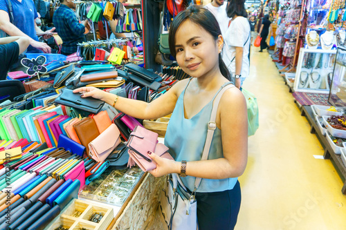 Beautiful asian young woman traveling and shopping at Chatuchak weekend market, Canvas Print