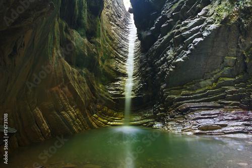 Küchenrückwand aus Glas mit Foto Wasserfalle Beautiful grotto with a pouring beautiful waterfall
